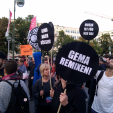 Demonstrators hold signs against the proposed GEMA measures