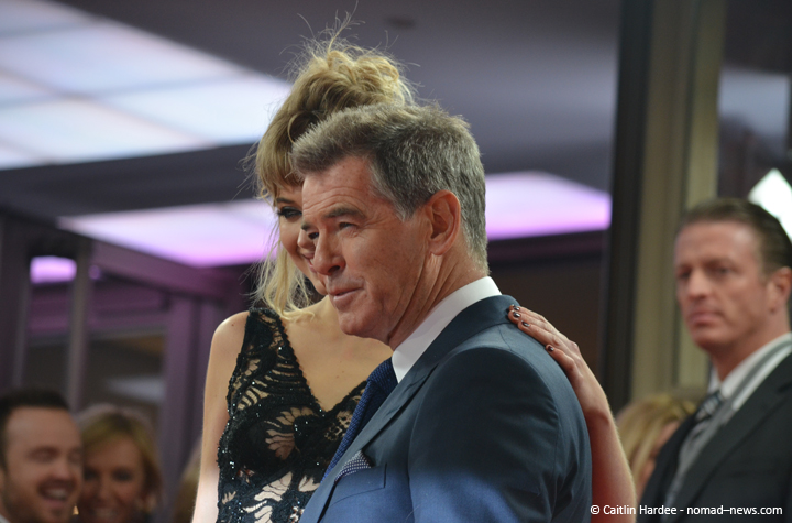 """""""A Long Way Down"""" costars Pierce Brosnan and Imogen Poots at the 2014 Berlinale film festival; Paul and Collette in the background."""