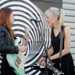 Larkin Poe rock out atop the Universal Germany building. Copyright: Caitlin Hardee